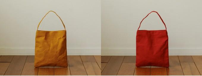 ハンドメイドで作られるオレンジ、レッドカラーのワンハンドルトートバッグ