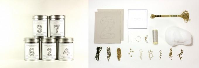 フランス刺繍家小林モー子が手がける数字のオーナメントが作れる刺繍キットの中身の針や糸、材料などと、数字が書いてある入れ物のシルバーの缶の写真