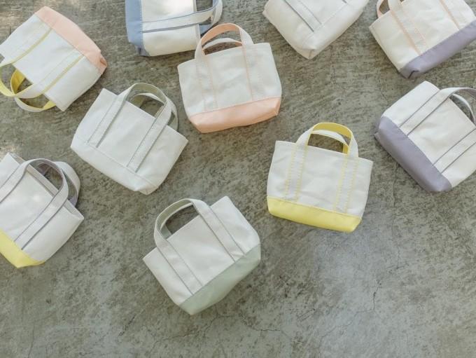グレー、イエロー、ピンク、ブルーなど、パステルカラーの帆布トートバッグ