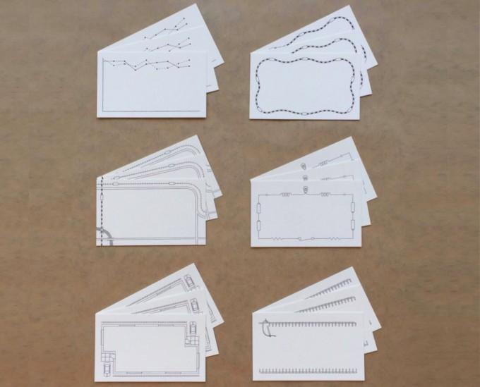 地図や回路図、間取りなどの罫線がデザインされたカード