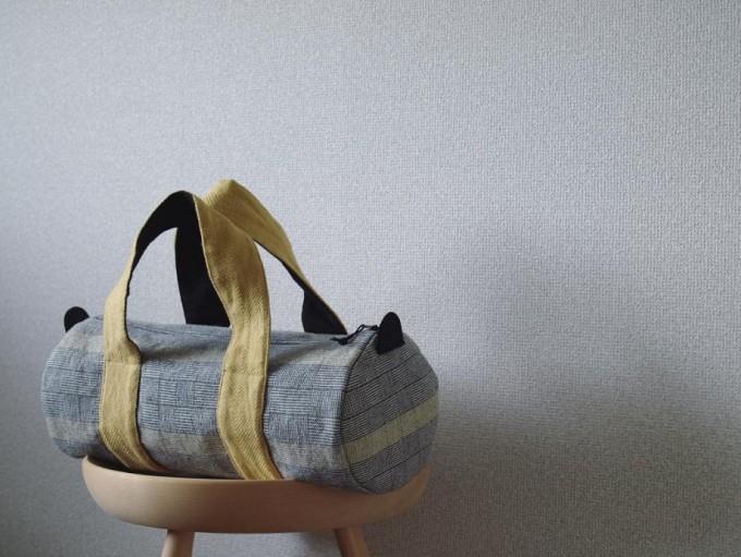裂き織りをアレンジして作られたグレートイエローのボストンバッグ
