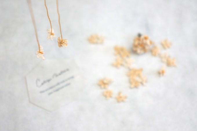 cotoyo matsueのロゴ、糸でつくられたお花のイメージビジュアル