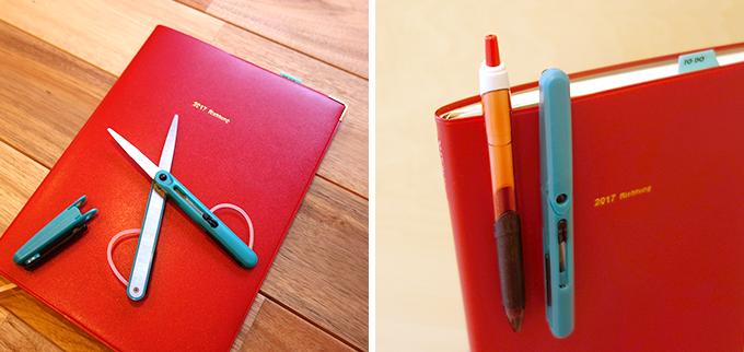 赤い手帳とはさみやペン