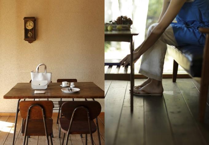 テーブルに置かれた白いバッグや青い洋服にサンダルを履いた女性
