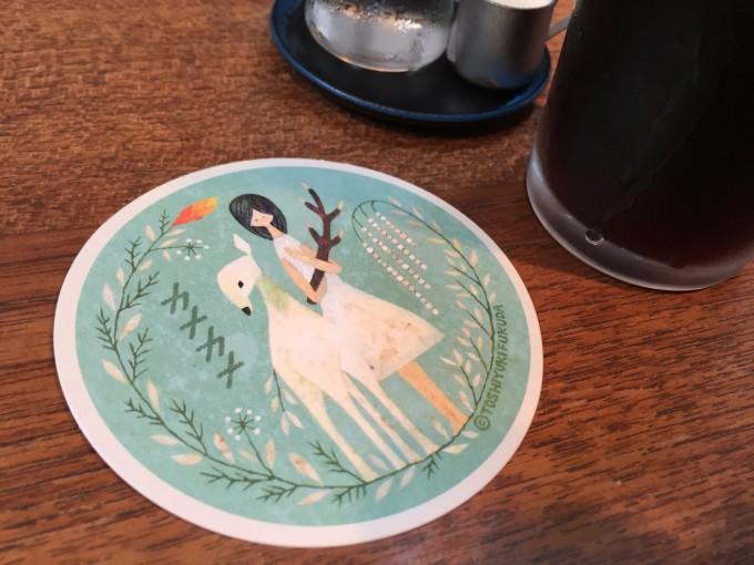 イラストレーターの福田利之さんが描いた奈良町のカフェ「カナカナ」のコースター