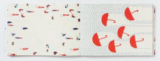PARIS 100枚レターブック 人や傘が描かれた紙の写真