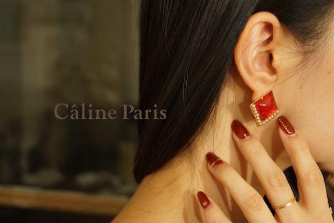 Câline Parisの赤いヴィンテージパーツ×ゴールドピアス