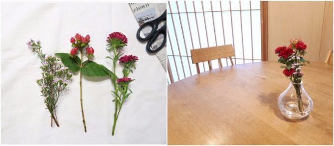 ダイニングテーブルの真ん中に置かれた赤い花の写真