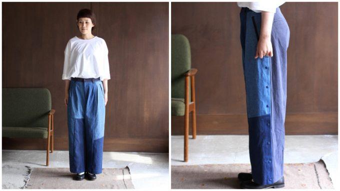 個性的なデザインのデニムパンツを履いた女性