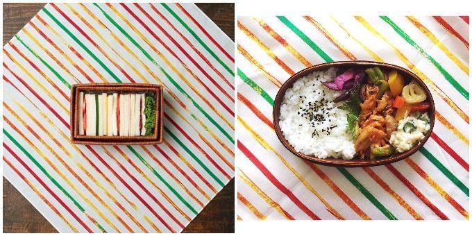 サンドイッチ、和風のお弁当とストライプのお弁当包みの組み合わせ