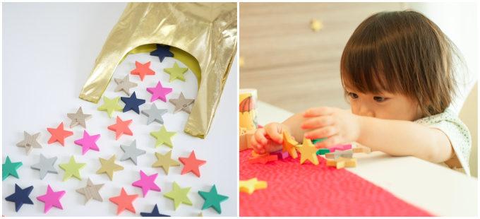 「kiko+」の星形のドミノとそれで遊ぶ子ども