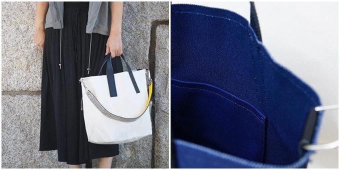 「TAKEYARI」の極厚2号帆布を使った2wayトートバッグを手に持っているところ