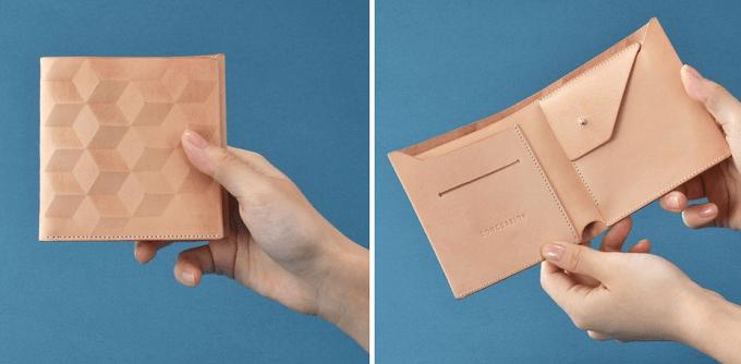 幾何学模様の入った「CONCUSSION」の革財布、コンパクタイプ