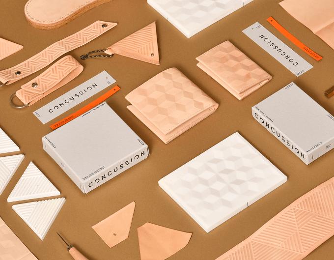 幾何学模様の入った「CONCUSSION」の革製品