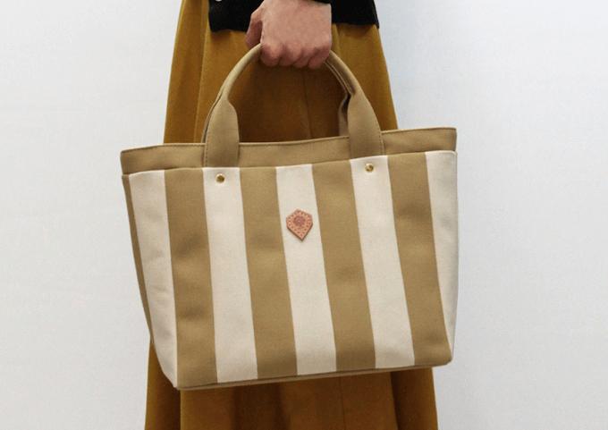 「jiyoh(ジヨウ)」のカラフルな帆布バッグ「ストライプトート」