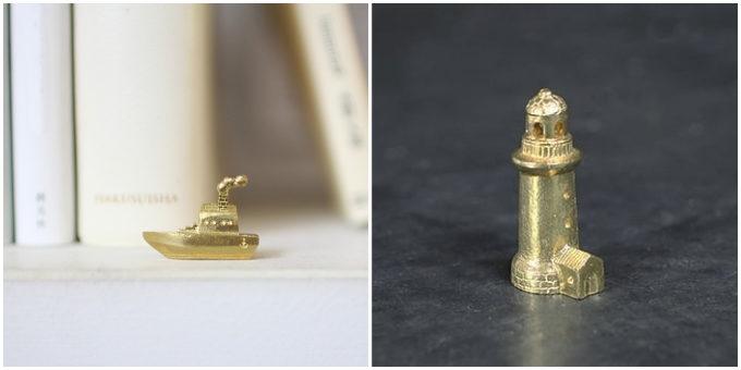 「穀雨」の真鍮製オブジェ「どこか遠くにある街」、船と灯台